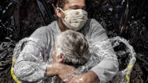 Nurse embracing patient in Brazil wearing 'hug curtain' wins World Press Photo of the Year- Technology News, FP